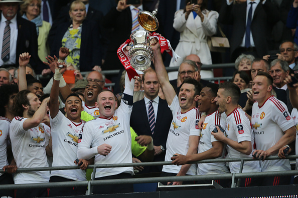 LONDON, ENGLAND - MAY 21:  Michael Carrick and Wayne Rooney of Manchester United lift the trophy following their 1-2 victory at the end of extra time during The Emirates FA Cup final match between Manchester United and Crystal Palace at Wembley Stadium on May 21, 2016 in London, England.  (Photo by Matthew Ashton - AMA/Getty Images)